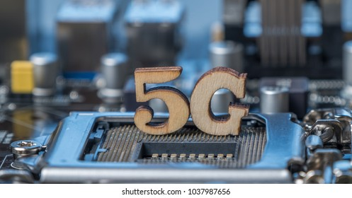 Wooden 5G symbol on computer motherboard. Conceptual image of the 5th generation wireless system