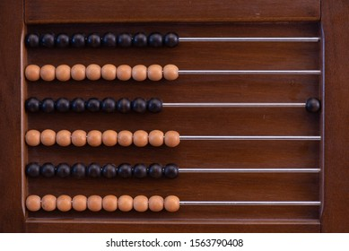 wooden abacus with black and white beans