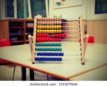 wooden abacus in the classroom to learn decimal numeral system to children with vintage old toned effect