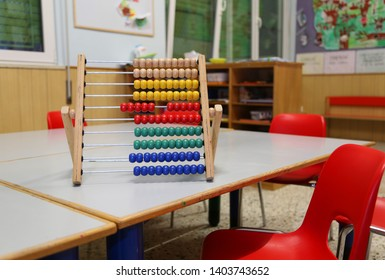 wooden abacus in the classroom to learn decimal numeral system to children