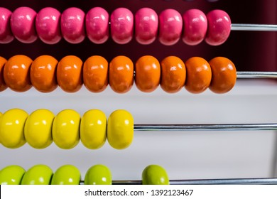 Wooden abacus with colored beads, toy to learn to count