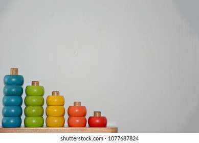 Wooden abacus used to train children. The colorful beads stimulate the kids.