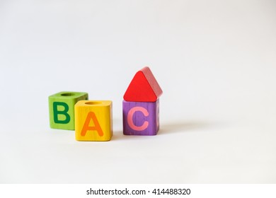 Wooden ABC Blocks on white background with copyspace