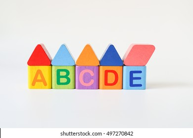 Wooden ABC Blocks writing word ABCDE on white background with copyspace, ABC Word for Learning and development background concept
