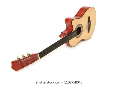 Wooden acoustic guitar facing with body towards back and neck towards the front. With white background and shadow beneath. Space for text.