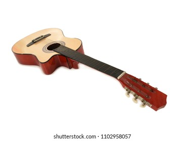 Wooden acoustic guitar on a white Floor with neck towards the front and body facing towards the background. Space for text.