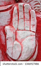 Wooden aged hand like stop sign painted red