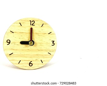 Wooden Alarm Clock, Round Alarm Clock shows to 9 . isolated on white