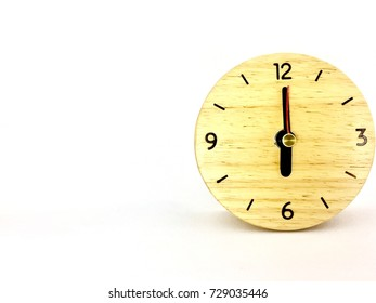 Wooden Alarm Clock, Round Alarm Clock shows to 12 . isolated on white