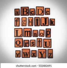 Wooden alphabet letters on a white background