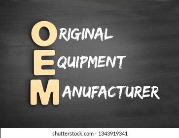 Wooden alphabets building the word OEM - Original Equipment Manufacturer acronym on blackboard