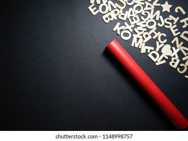 Wooden alphabets and red scroll