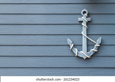 wooden anchor on wall background