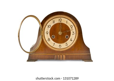 Wooden antique table clock on a white background. Clipping path