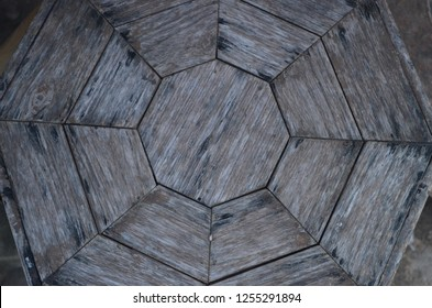 Wooden antique table with hexagon angled pattern looking old and worn out, some dirts and rusty scratches found on the surface texture