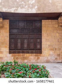 Wooden arabesque window, Mashrabiya, in exterior stone bricks wall of ottoman era old historic El Sehemy building, Moez Street, Cairo, Egypt