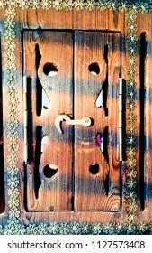 A wooden arabian style shutter on a mirror