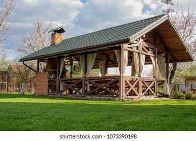 Wooden arbor on the green grass for relaxation