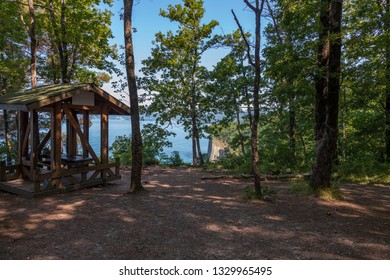 wooden arbor under the oak trees near the sea, summer camping area near kiselev rock Tuapse, Russia.