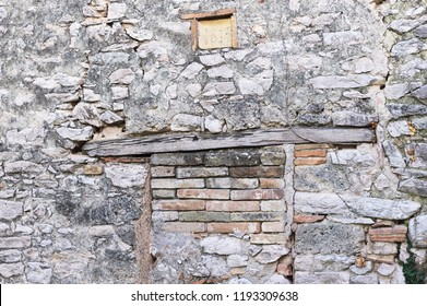 Wooden architrave of a walled brick door (Marche, Italy, Europe)