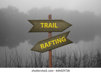 Wooden arrow signs in nature with options Trail and Rafting