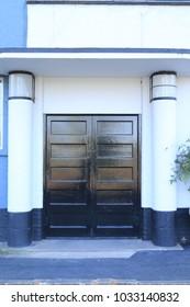 Wooden art deco door. Wooden door in an art deco style from an English public house.