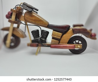 wooden art motorcycle side studio closeup isolated white background
