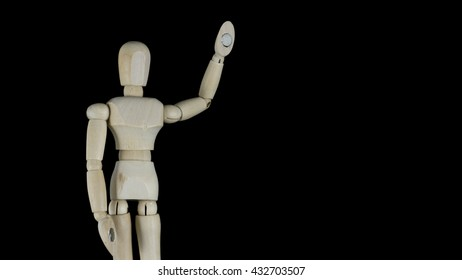 Wooden articulated art model dummy mannequin doll on a black background.