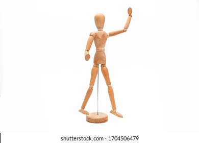 Wooden articulated mannequin body on white background