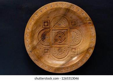Wooden artisan plate. Handmade Ukrainian  bowl. Ornamental tradi