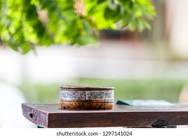 Wooden ashtray on a wooden table on a sunny day