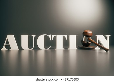 Wooden auction gavel on grey background