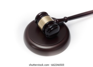 Wooden auctioneer or judges gavel for dispensing justice or knocking down sale prices agains white background