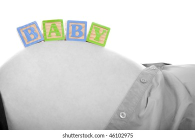 Wooden BABY blocks on Pregnant Tummy.