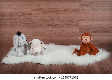 Wooden backdrop with sheepskin rug and colourful teddies
