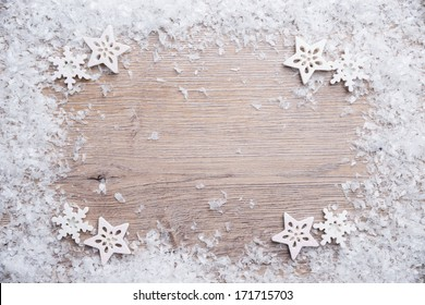 wooden background with artificial snow