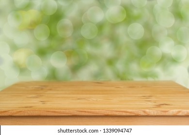 Wooden background with blurred green background