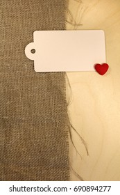 Wooden background with burr, label and heart