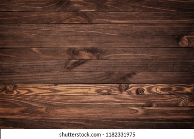 Wooden background with copyspace, brown striped timber desk, old table or floor