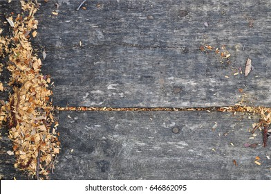 Wooden background. Wooden dark boards. Sawdust. Shavings. Wood texture. Great format. Place for the text. The floor and the path are made of wood. In the woods.