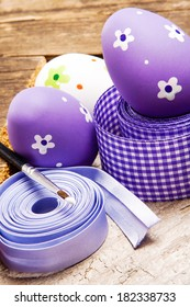 The wooden background decorated Easter eggs.