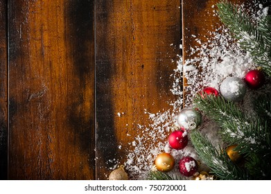 wooden background with fir tree branches and decorations, Christmas and New Year concept