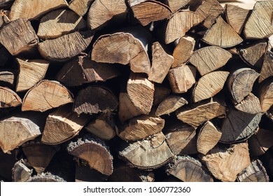 Wooden background. Firewood for the winter, stacks of firewood, pile of firewood