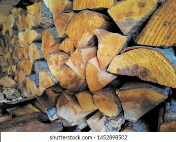 Wooden background. Firewood for the winter. Stacks of Firewood. Preparation of firewood for the winter. Pile of wood.Firewood background