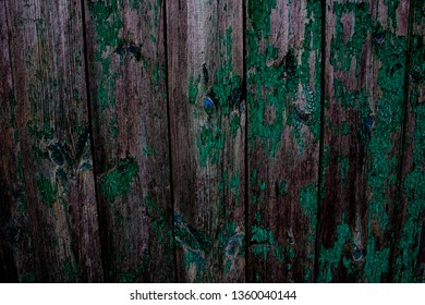Wooden background with green tint.