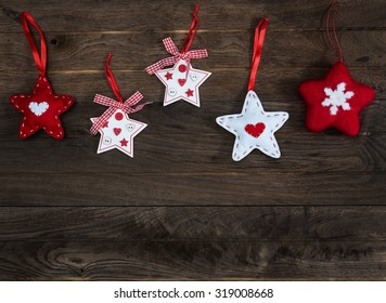 Wooden background with hand made stars on top