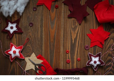 Wooden background and handmade toys for Christmas, process. Many copy space