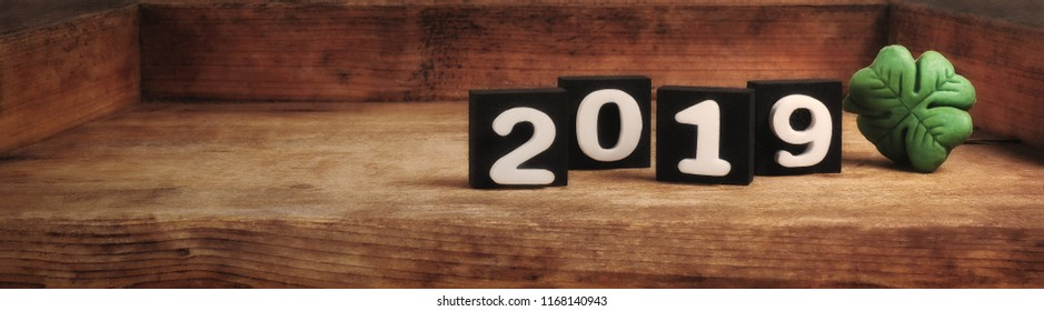 wooden background of the new year 2019 with shamrock