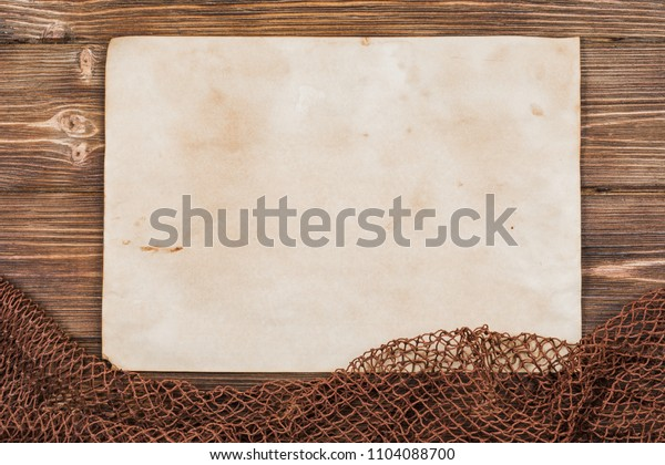 Wooden background with old fishing net