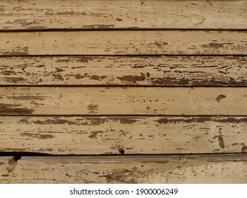 wooden background from old painted boards. the facade of the old building. Place for text